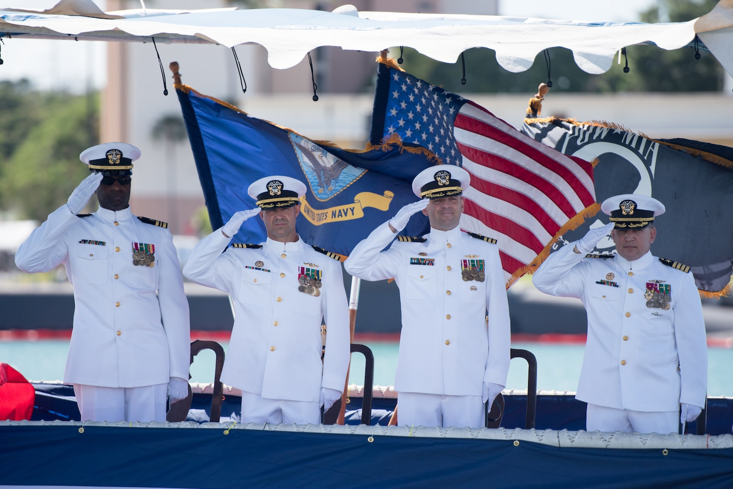 PEARL HARBOR (August 3, 2018) - The official party salutes during the change of command ceremony for Los Angles-class fast-attack submarine USS Columbia (SSN 771) on the historic submarine piers at Joint Base Pearl Harbor-Hickam, August 3. Cmdr. Tyler Forrest relieved Cmdr. Dave Edgerton as Columbia's commanding officer. (U.S. Navy photo by Mass Communication Specialist 1st Class Daniel Hinton)