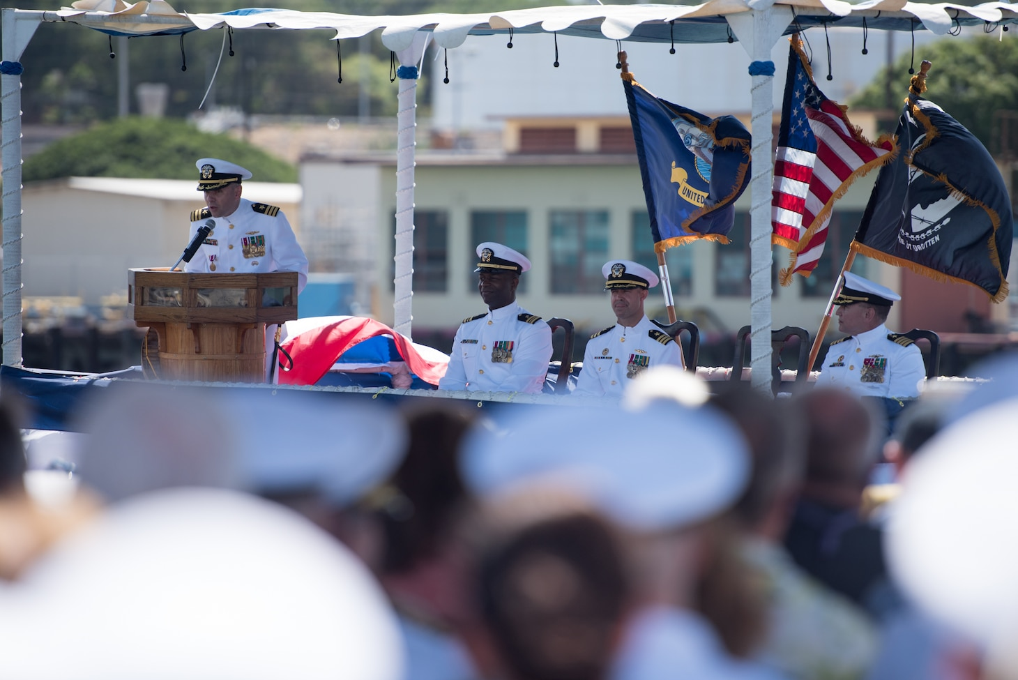PEARL HARBOR (August 3, 2018) - Cmdr. Dave Edgerton, outgoing commanding officer of Los Angles-class fast-attack submarine USS Columbia (SSN 771) delivers remarks during the change of command ceremony on the historic submarine piers at Joint Base Pearl Harbor-Hickam, August 3. Cmdr. Tyler Forrest relieved Cmdr. Dave Edgerton as Columbia's commanding officer. (U.S. Navy photo by Mass Communication Specialist 1st Class Daniel Hinton)