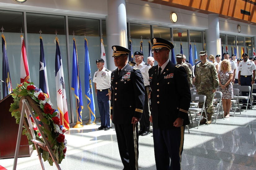 Lt. Gen. Michael X. Garrett (left), commanding general U.S. Army Central and Col. Joey T. Byrd (right), USARCENT chaplain  stand with the fellow Soldiers, civilians, community leaders and family members for a moment of silence at the USARCENT wreath laying ceremony Aug. 3 at Patton Hall to honor service members who died while assigned to USARCENT/Third Army over the past 100 years.