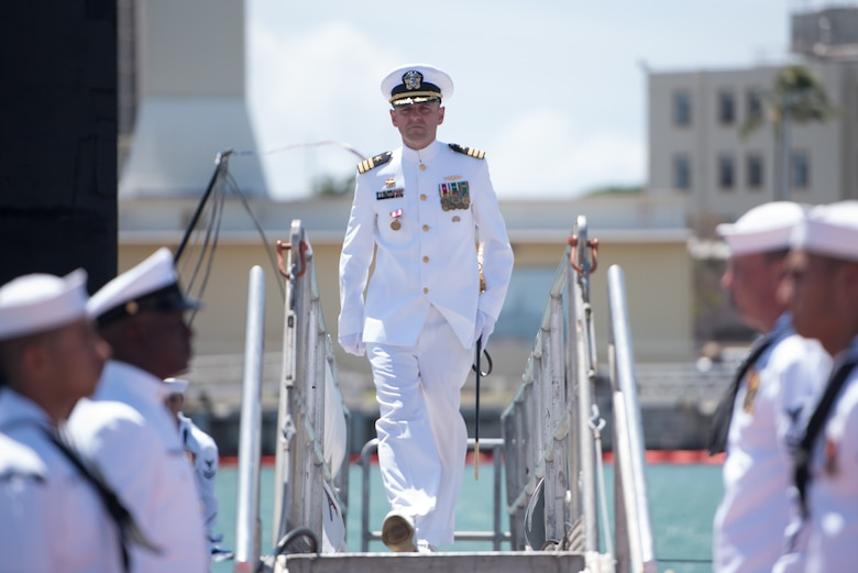 PEARL HARBOR (August 3, 2018) - Cmdr. Dave Edgerton, outgoing commanding officer of Los Angles-class fast-attack submarine USS Columbia (SSN 771) walks of the submarine after the change of command ceremony on the historic submarine piers at Joint Base Pearl Harbor-Hickam, August 3. Cmdr. Tyler Forrest relieved Cmdr. Dave Edgerton as Columbia's commanding officer. (U.S. Navy photo by Mass Communication Specialist 1st Class Daniel Hinton)