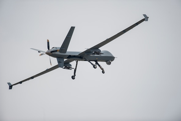 An MQ-9 Reaper performs a low pass during a first-ever air show demonstration May 29, 2016, at Cannon Air Force Base, N.M. The 2016 Cannon Air Show highlights the unique capabilities and qualities of Cannon's Air Commandos and also celebrates the long-standing relationship between the 27th Special Operations Wing and the High Plains community.  (U.S. Air Force photo/Master Sgt. Dennis J. Henry Jr.)