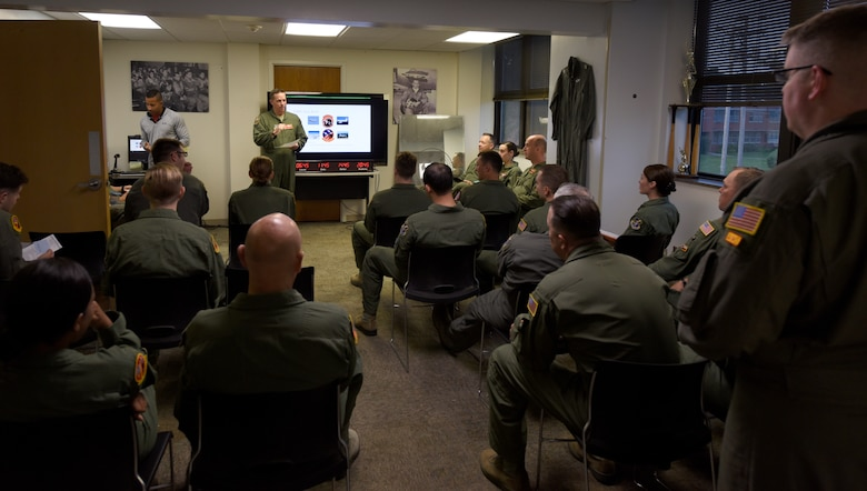 Nebraska National Guard Lt. Col. Mike Holdcroft, 170th Operational Support Squadron commander, leads a preflight mission-briefing Aug. 4, 2018 at Offutt Air Force Base, Nebraska. Holdcroft was the aircraft commander of the RC-135V/W Rivet Joint weekend training sortie with a flight and mission crew comprised almost exclusively of reserve component Airmen. The objective of the preflight briefing is to communicate a common operating picture of meteorological and aeronautical information to the entire crew necessary for the conduct of a safe and efficient flight. (U.S. Air Force photo by 2nd Lt. Drew Nystrom)