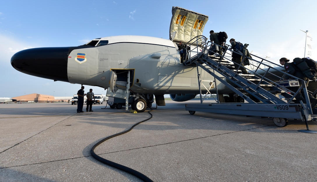 Crewmembers board an Offutt-based RC-135V/W Rivet Joint Aug. 5, 2018 before a unique training sortie which saw the flight and mission-crew comprised almost exclusively of reserve component Airmen. The aircraft is an extensively modified C-135. The Rivet Joint's modifications are primarily related to its on-board sensor suite, which allows the mission crew to detect, identify and geolocate signals throughout the electromagnetic spectrum. The mission crew can then forward gathered information in a variety of formats to a wide range of consumers via Rivet Joint's extensive communications suite. (U.S. Air Force photo by 2nd Lt. Drew Nystrom)