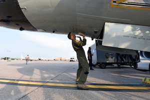 Nebraska National Guard Lt. Col. Mike Holdcroft, 170th Operational Support Squadron commander, conducts a preflight inspection of a RC-135V/W Rivet Joint Aug. 5, 2018 at Offutt Air Force Base, Nebraska. Holdcroft was the aircraft commander of a unique training sortie with a flight and mission-crew comprised almost exclusively of reserve component Airmen. The aircraft is an extensively modified C-135. The Rivet Joint's modifications are primarily related to its on-board sensor suite, which allows the mission crew to detect, identify and geolocate signals throughout the electromagnetic spectrum. The mission crew can then forward gathered information in a variety of formats to a wide range of consumers via Rivet Joint's extensive communications suite. (U.S. Air Force photo by 2nd Lt. Drew Nystrom)