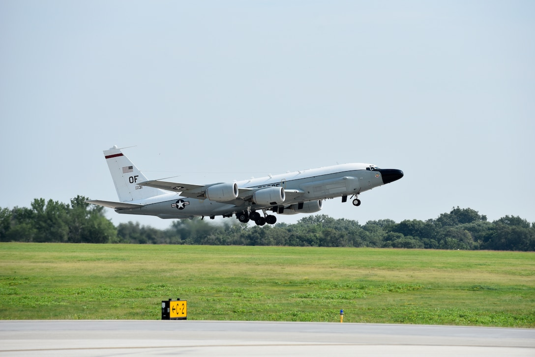 An Offutt-based RC-135V/W Rivet Joint takes flight Aug. 5, 2018 at Offutt Air Force Base, Nebraska. The aircraft was flown during a unique training sortie with a flight and mission-crew comprised almost exclusively of reserve component Airmen. The aircraft is an extensively modified C-135. The Rivet Joint's modifications are primarily related to its on-board sensor suite, which allows the mission-crew to detect, identify and geolocate signals throughout the electromagnetic spectrum. The mission-crew can then forward gathered information in a variety of formats to a wide range of consumers via Rivet Joint's extensive communications suite. (U.S. Air Force photo by 2nd Lt. Drew Nystrom)