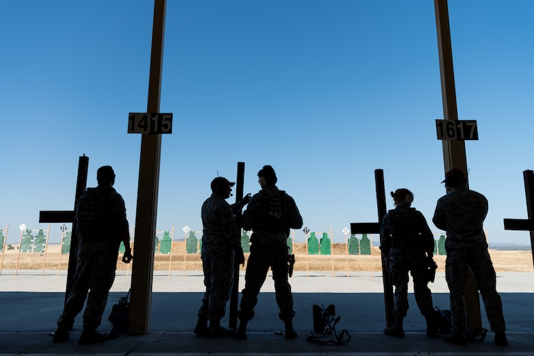 Airmen with the 9th and 940th Security Forces combat arms training and maintenance shop work alongside each other during range instruction at Beale Air Force Base, California, July 7, 2018. Airmen from both the active-duty component and reserves use the same range for qualification. (U.S. Air Force photo by Senior Airman Justin Parsons)