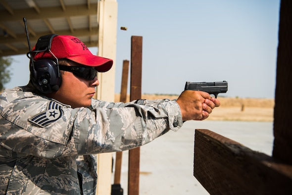Staff Sgt. Jude Mares, 9th Security Forces combat arms training and maintenance instructor, discharges his fire arm during a training course meant to help instructors to stray proficient with weapon systems at Beale Air Force Base, California, July 31, 2018 . CATM instructors are trained at Joint Base San Antonio-Lackland, Texas and are recertified on an annual basis by their shops NCOIC. (U.S. Air Force photo by Senior Airman Justin Parsons)