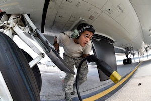 Senior Airman Angel Marroquin, 55th Aircraft Maintenance Squadron, disconnects an external power cord from a RC-135V/W Rivet Joint Aug. 5, 2018 at Offutt Air Force Base, Nebraska. The aircraft is an extensively modified C-135. The Rivet Joint's modifications are primarily related to its on-board sensor suite, which allows the mission-crew to detect, identify and geolocate signals throughout the electromagnetic spectrum. The mission-crew can then forward gathered information in a variety of formats to a wide range of consumers via Rivet Joint's extensive communications suite. (U.S. Air Force photo by 2nd Lt. Drew Nystrom)