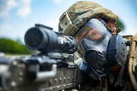 A U.S. Marine with Black Sea Rotational Force 18.1, prepares to engage targets with a M240B machine gun while wearing his gas mask during Exercise Platinum Lion 18 at Novo Selo Training Area, Bulgaria, Aug. 3, 2018. Platinum Lion is an annual field training exercise that reinforces relationships in a joint training environment, builds understanding of partner nation tactics, techniques and procedures, and increases interoperability with Allied and partner forces.