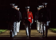 "Staff Sgt. Codie Williams, ceremonial bugler, ""The Commandant's Own,"" U.S. Marine Drum & Bugle Corps, marches off Center Walk during a Friday Evening Parade at Marine Barracks Washington D.C., August 3, 2018. The guests of honor for the parade were Ms. Ryan Manion, president, Travis Manion Foundation, and U.S. Marine Corps Col. Tom Manion, retired, chairman emeritus, Travis Manion Foundation. The hosting official was Lt. Gen. Michael G. Dana, director, Marine Corps Staff."
