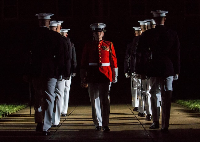 """Staff Sgt. Codie Williams, ceremonial bugler, """"The Commandant's Own,"""" U.S. Marine Drum & Bugle Corps, marches off Center Walk during a Friday Evening Parade at Marine Barracks Washington D.C., August 3, 2018. The guests of honor for the parade were Ms. Ryan Manion, president, Travis Manion Foundation, and U.S. Marine Corps Col. Tom Manion, retired, chairman emeritus, Travis Manion Foundation. The hosting official was Lt. Gen. Michael G. Dana, director, Marine Corps Staff."""
