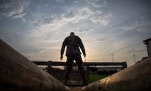A Marine with Marine Wing Support Squadron 172, Marine Aircraft Group 36, 1st Marine Aircraft Wing, engages in the obstacle course at Camp Hansen, Okinawa, Japan, August 3, 2018. The MWSS-172 Marines participated in the obstacle course together to boost morale and strengthen unit cohesion. The Marines utilize proper technique instead of muscling through the course to reduce risk of injury.