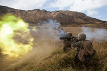 U.S. Marine Corps Lance Cpl. Shane Craig, a rifleman with Lima Company, 3rd Battalion, 3rd Marine Regiment, III Marine Expeditionary Force, fires an AT4 rocket launcher a during a combined arms exercise at the Kaneohe Bay Range Training Facility, Marine Corps Base Hawaii, Aug. 3, 2018. During the exercise, U.S. Marines utilized machine gun suppression and mortar fire on simulated enemy forces, while infantrymen assaulted forward towards them.
