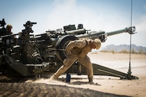 U.S. Marine Corps Cpl. Elijah Feliciano, an assistant gunner with 2nd Battalion, 11th Marines, 1st Marine division, pulls the firing cord on an M777 towed 155mm howitzer during exercise Summer Fury, at Range 2057 South, Calif., Aug. 1, 2018. The exercise was conducted to increase 1st MARDIV operations proficiency by incorporating establishing, transitioning and phasing control of aircraft and missiles across multiple locations.