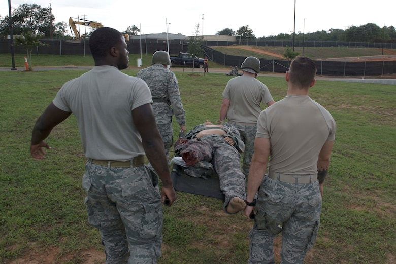U.S. Airmen assigned to the 20th Medical Group carry a simulated patient during an exercise at Shaw Air Force Base, S.C., Aug. 2, 2018.