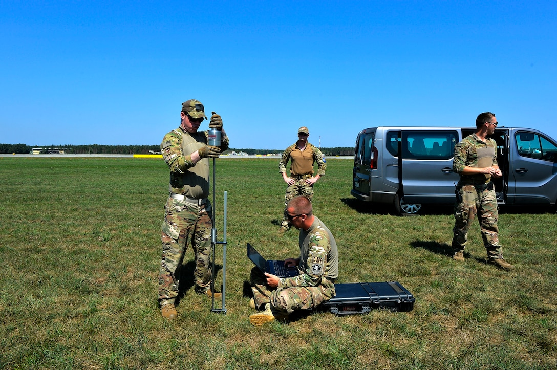 U.S. Airmen assigned to the 435th Contingency Response Group use a penetrometer to measure the load-bearing capacity of the ground on a landing zone at Powidz Air Base, Poland. Estimating the load-bearing capacity of the ground is one of the first steps to take in establish landing and drop zones. (U.S. Air Force photo by Senior Airman Joshua Magbanua)