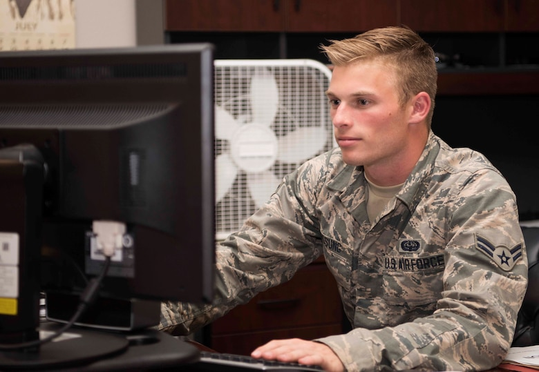 Airman 1st Class Ryan Hussung, 30th Space Communication Squadron Airman, works on a computer July 18, 2018, on Vandenberg Air Force Base, Calif. Hussung works for the knowledge management center in the squadron.