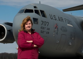 Retired Senior Master Sgt. Kathleen Lambert, a former 512th Airlift Wing loadmaster, stands in front of a C-17 Globemaster III on the flightline at Dover Air Force Base, Del., March 6, 2018. Lambert amassed more than 3,100 flight hours as a C-17 flyer and became an evaluator and instructor loadmaster during her 33-year reserve career. (U.S Air Force photo by Senior Airman Zachary Cacicia)