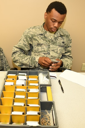 Airman 1st Class Jaylin Bailey, lodging journeyman, 127th Force Support Squadron, Selfridge Air National Guard Base, Mich., assists in out processing members of the 127th Wing on August 2, 2018 at the Alpena Combat Readiness Training Center here.