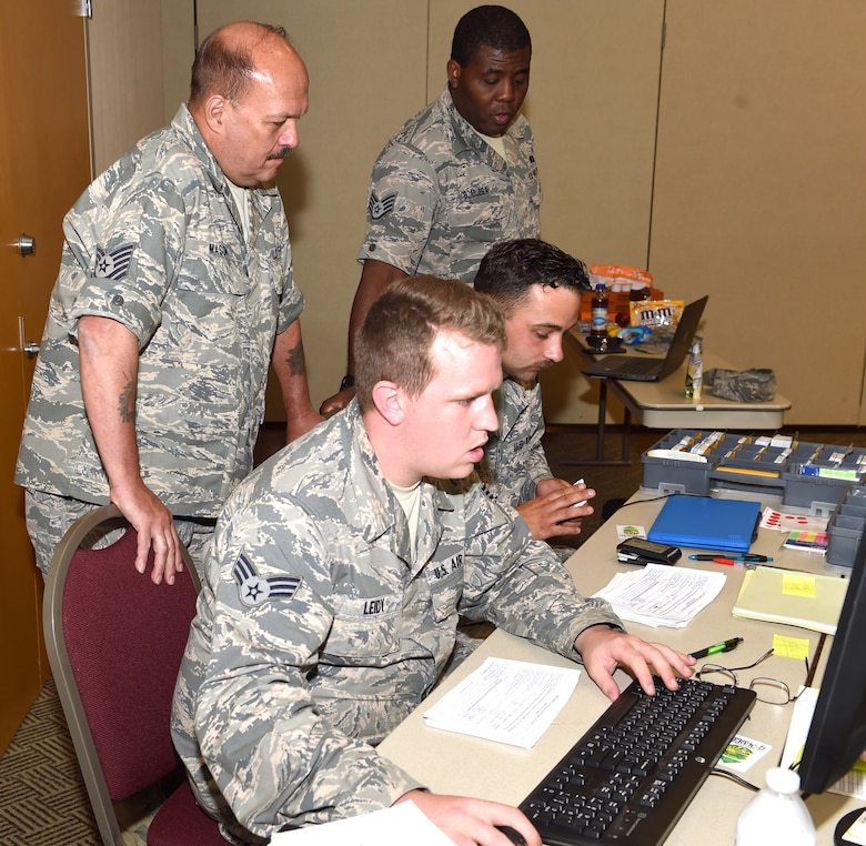 Tech. Sgt. Ben Mason, Staff Sgt. Emuobosan Ojaruega, Senior Airman Joshua Leidy and Airman 1st Class Angelo Raona, all lodging team members from the 127th Force Support Squadron, Selfridge Air National Guard Base, Mich., assist in managing lodging assignments during Exercise Northern Strike 18 at Alpena Combat Readiness Training Center on August 4, 2018.