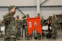 "Capt. Emmett Schneider, company commander for the 620th Signal Company, performs a salute during a color casing ceremony held Aug. 5, 2018, at the Hershel ""Woody"" Williams Armed Forces Reserve Center in Fairmont, West Virginia. The color casing ceremony marked the company's deactivation after nine years of providing enhanced Warfighter Information Network-Tactical capabilities to missions around the state and the world. (U.S. Army National Guard photo by Sgt. Zoe Morris)"
