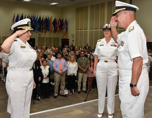 Rear Adm. Tina Davidson (left) assumes command of Navy Medicine Education, Training and Logistics Command, or NMETLC, during a combined change of command and retirement ceremony. Davidson will serve as NMETLC's second commanding officer.