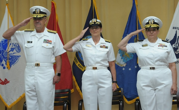 (From left) Vice Adm. Forrest Faison, Navy Surgeon General; Rear Adm. Tina Davidson, commander, Navy Medicine Education, Training and Logistics Command commander; and retired Rear Adm. Rebecca McCormick-Boyle, former NMETLC Commander.