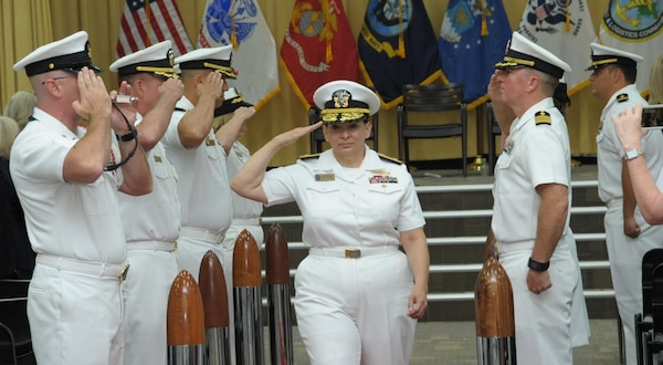 Rear Adm. Tina Davidson is piped aboard before assuming command during the Navy Medicine Education, Training and Logistics Command combined change of command and retirement ceremony Aug. 3 at Joint Base San Antonio-Fort Sam Houston.
