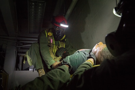 Extract Marines with Chemical Biological Incident Response Force assist and extract a survivor out of a simulated collapsed building during Exercise Chicago Response in Champaign, Illinois, July 25, 2018. This was the first time the active duty response force trained with Chicago-area first responders and served to establish a working relationship between CBIRF and the city of Champaign and Chicago.