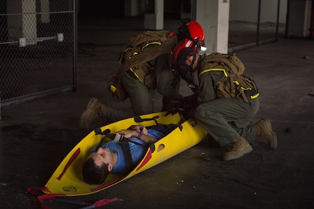 Extract Marines with Chemical Biological Incident Response Force pull a survivor out of a simulated collapsed building during Exercise Chicago Response in Champaign, Illinois, July 25, 2018. This was the first time the active duty response force trained with Chicago-area first responders and served to establish a working relationship between CBIRF and the city of Champaign and Chicago.