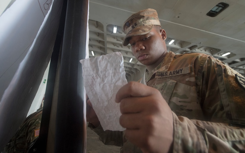 U.S. Army Spc. Takory Coleman, 149th Seaport Operations Company, 10th Transportation Battalion, 7th Transportation Brigade, records information during Exercise Dragon Lifeline July 31, 2018, at the Federal Law Enforcement Training Center in Charleston, S.C. The 841st Transportation Battalion hosted the exercise, facilitating training for Soldiers assigned to Fort Bragg, N.C., and Fort Eustis, Va. The exercise was designed to train participants in the planning and processes of rail, convoy, port and vessel operations.