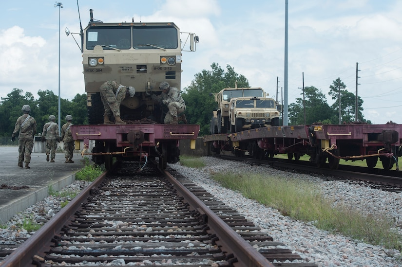 U.S. Army Soldiers conduct rail operations during Exercise Dragon Lifeline July 31, 2018, at Joint Base Charleston's Naval Weapons Station, S.C. The 841st Transportation Battalion hosted the exercise, facilitating training for Soldiers assigned to Fort Bragg, N.C., and Fort Eustis, Va. The exercise was designed to train participants in the planning and processes of rail, convoy, port and vessel operations.