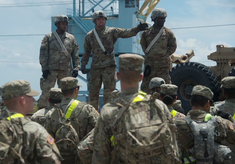 U.S. Army Sgt. Micheal Suarez, center, 359th Inland Cargo Transfer Company, 10th Transportation Battalion, 7th Sustainment Brigade, briefs Soldiers prior to conducting rail operations as part of Exercise Dragon Lifeline July 31, 2018, at Joint Base Charleston's Naval Weapons Station, S.C. The 841st Transportation Battalion hosted the exercise, facilitating training for Soldiers assigned to Fort Bragg, N.C., and Fort Eustis, Va. The exercise was designed to train participants in the planning and processes of rail, convoy, port and vessel operations.