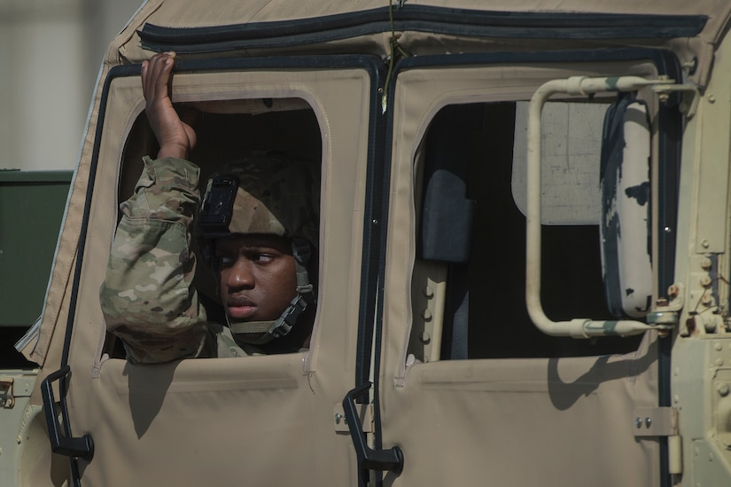 A U.S. Army Soldier looks out the window of a Humvee during rail operations as part of Exercise Dragon Lifeline Aug. 1, 2018, at Joint Base Charleston's Naval Weapons Station, S.C. The 841st Transportation Battalion hosted the exercise, facilitating training for Soldiers assigned to Fort Bragg, N.C., and Fort Eustis, Va. The exercise was designed to train participants in the planning and processes of rail, convoy, port and vessel operations.