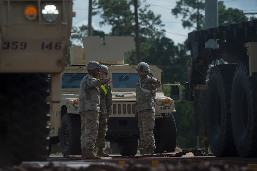 U.S. Army Soldiers prepare to move vehicles during rail operations as part of Exercise Dragon Lifeline Aug. 1, 2018, at Joint Base Charleston's Naval Weapons Station, S.C. The 841st Transportation Battalion hosted the exercise, facilitating training for Soldiers assigned to Fort Bragg, N.C., and Fort Eustis, Va. The exercise was designed to train participants in the planning and processes of rail, convoy, port and vessel operations.