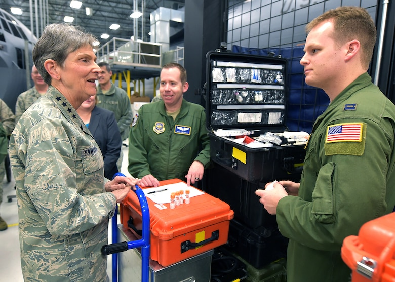 Gen. Ellen Pawlikowski, Air Force Materiel Command commander, discusses job responsibilities with Capts. Paul Merrill (center) and Matthew Decker,
