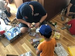 Distribution Sasebo sailors volunteer time to local orphanage