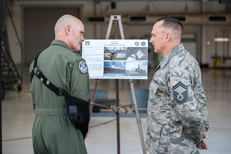 The commander of Air Mobility Command, Gen. Carlton D. Everhart II (left), speaks with Senior Master Sgt. Mike Delph of the 123rd Maintenance Group during a tour of the Kentucky Air National Guard Base in Louisville, Ky., Aug. 3, 2018. The group played a key role in hurricane recovery operations last year. (U.S. Air National Guard photo by Master Sgt. Phil Speck)
