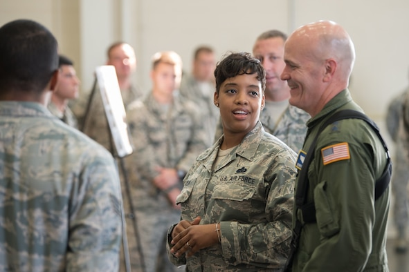 The commander of Air Mobility Command, Gen. Carlton D. Everhart II (right), receives a briefing from Master Sgt. Zakiya Taylor of the 123rd Force Support Squadron about the unit's support of hurricane response operations last year during a tour of the Kentucky Air National Guard Base in Louisville, Ky., Aug. 3, 2018. (U.S. Air National Guard photo by Master Sgt. Phil Speck)