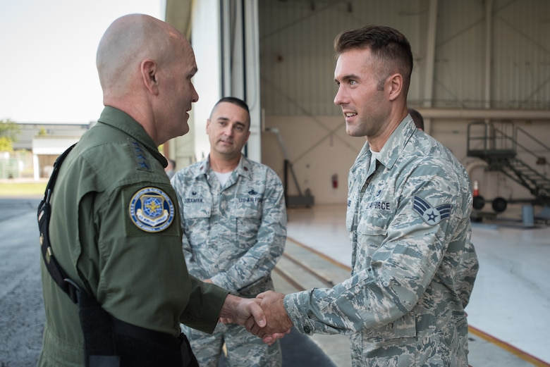 The commander of Air Mobility Command, Gen. Carlton D. Everhart II (left), speaks with Senior Airman Hans Larsen of the 123rd Maintenance Group during a tour of the Kentucky Air National Guard Base in Louisville, Ky., Aug. 3, 2018. The group sponsors an annual Guard-wide training event for C-130 maintainers to ensure currency on key tasks. (U.S. Air National Guard photo by Lt. Col. Dale Greer)