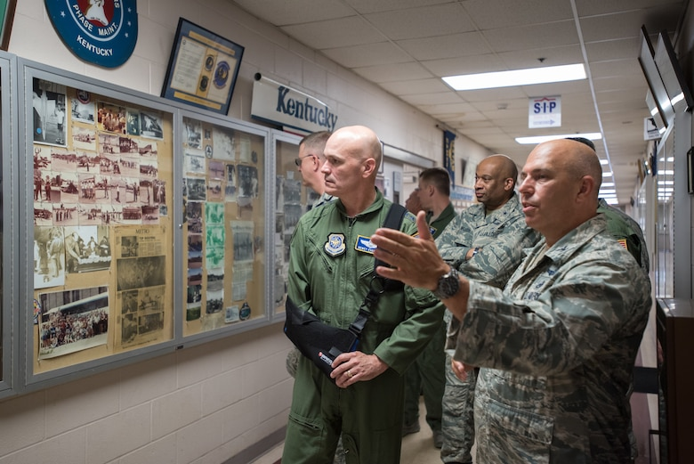 The commander of Air Mobility Command, Gen. Carlton D. Everhart II (left), views historical displays during a tour of the Kentucky Air National Guard Base in Louisville, Ky., Aug. 3, 2018. The wing is home to 1,200 Airmen and eight C-130H Hercules aircraft. (U.S. Air National Guard photo by Lt. Col. Dale Greer)