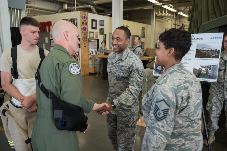 The commander of Air Mobility Command, Gen. Carlton D. Everhart II (second from left), greets Staff Sgt. Raymond Ray of the 123rd Force Support Squadron during a tour of the Kentucky Air National Guard Base in Louisville, Ky., Aug. 3, 2018. The squadron provided mobile field kitchen assets for hurricane recovery efforts in the Caribbean last year. (U.S. Air National Guard photo by Lt. Col. Dale Greer)
