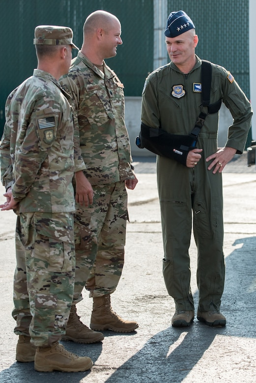 The commander of Air Mobility Command, Gen. Carlton D. Everhart II (right), speaks with Airmen from the 123rd Contingency Response Group during a tour of the Kentucky Air National Guard Base in Louisville, Ky., Aug. 3, 2018. The group was instrumental in hurricane recovery efforts last year. (U.S. Air National Guard photo by Lt. Col. Dale Greer)