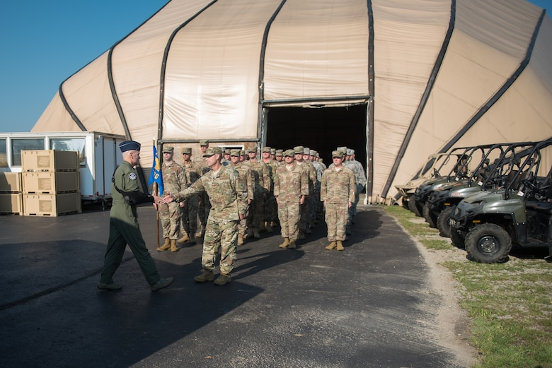 The commander of Air Mobility Command, Gen. Carlton D. Everhart II, greets Airmen from the 123rd Contingency Response Group during a tour of the Kentucky Air National Guard Base in Louisville, Ky., Aug. 3, 2018. The group was instrumental in hurricane recovery efforts last year. (U.S. Air National Guard photo by Airman Chloe Ochs)