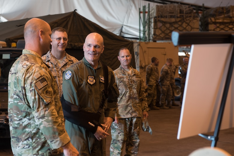 The commander of Air Mobility Command, Gen. Carlton D. Everhart II (second from right), speaks with Airmen from the 123rd Contingency Response Group during a tour of the Kentucky Air National Guard Base in Louisville, Ky., Aug. 3, 2018. The group was instrumental in hurricane recovery efforts last year. (U.S. Air National Guard photo by Airman Chloe Ochs)