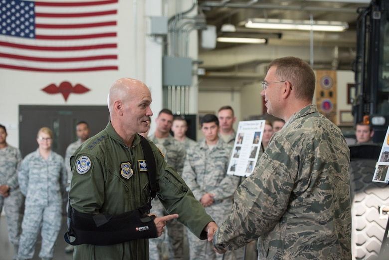 The commander of Air Mobility Command, Gen. Carlton D. Everhart II (left), receives a briefing on Critical Care Air Transport Teams from Maj. Thomas Hagan of the 123rd Medical Group during a tour of the Kentucky Air National Guard Base in Louisville, Ky., Aug. 3, 2018. The group is the only unit in the Air National Guard with two CCATTs. (U.S. Air National Guard photo by Airman Chloe Ochs)