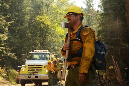 Washington Air National Guard Staff Sgt. Eric Delaune, 141st Maintenance Squadron, takes a break from fighting the Sheep Creek fire Aug. 6, 2018, near Northport, Wash. Delaune is on a hand crew that clears out burnable materials from the path of the fire to deny it fuel to spread.