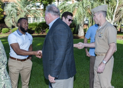 PANAMA CITY, Florida - Naval Surface Warfare Center Panama City Division (NSWC PCD) Technical Director Ed Stewart (SES) (left) and Executive Officer Cmdr. Kevin Christenson, USN, (right), welcomes NSWC PCD's newly hired federal civil service employees at the flagpole Aug. 6, 2018. U.S. Navy photos by Eddie Green