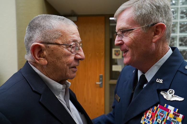 Maj. Gen. Gregory L. Ferguson (right), former and 14th wing commander of the now 137th Special Operations Wing, Will Rogers Air National Guard Base in Oklahoma City, greets retired Maj. Gen. Stanley F.H. Newman, the fourth 137th wing commander, before Ferguson's retirement ceremony at Will Rogers Air National Guard Base, Aug. 4, 2018.