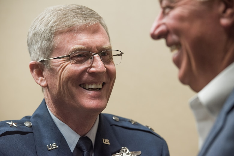 Maj. Gen. Gregory L. Ferguson, Air National Guard assistant to the commander, Air Force Special Operations Command (AFSOC), Hurlburt Field, Florida, greets a guest before his retirement ceremony at Will Rogers Air National Guard Base in Oklahoma City, Aug. 4, 2018.